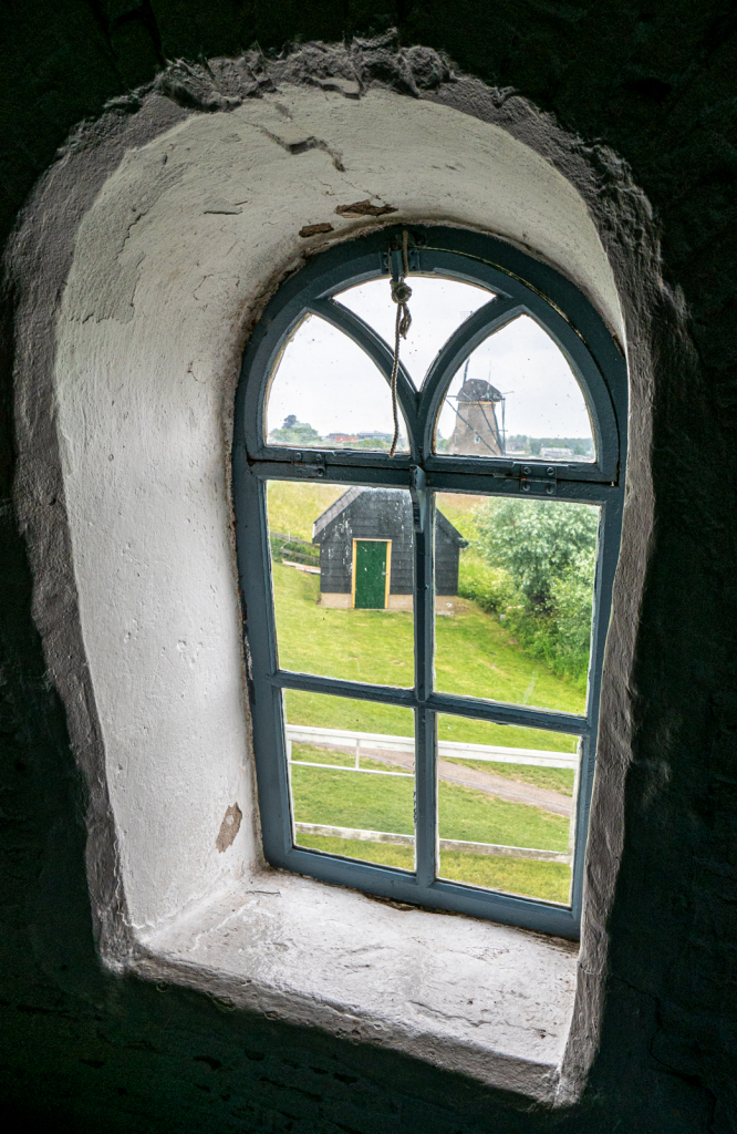looking through a window in the mill.
