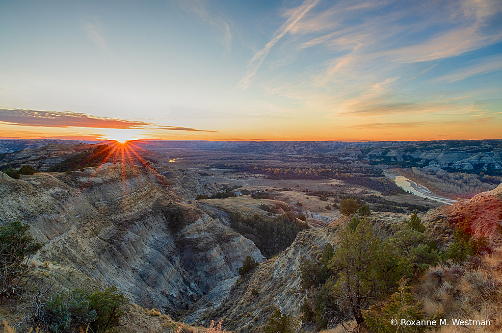 Sun rising over the badlands