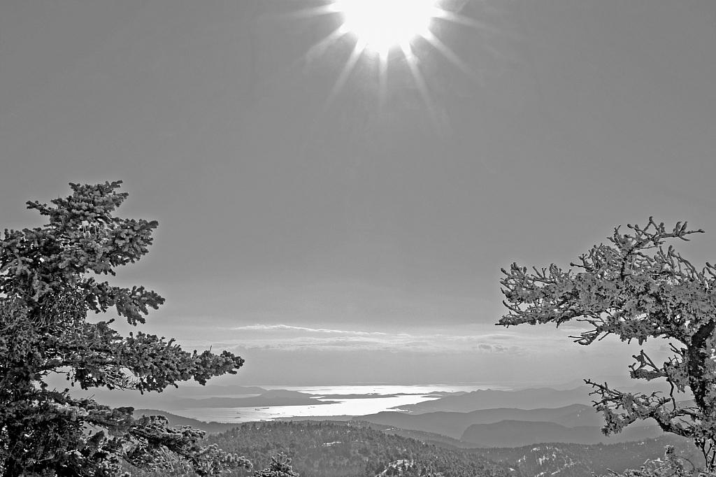 Bright sun over winter landscape.