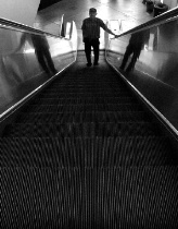 Man on an Escalator