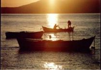 fishermen in the sunrise