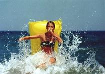 Nina riding the waves