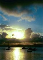 Sailboats watch sunset