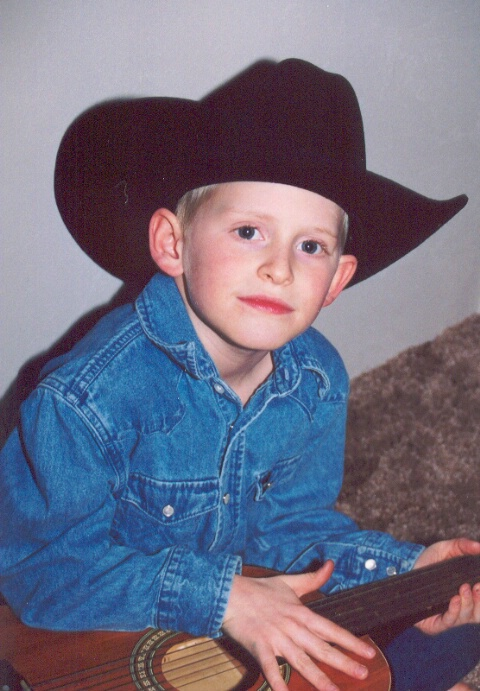 Austin, my little cowboy and future singing star.