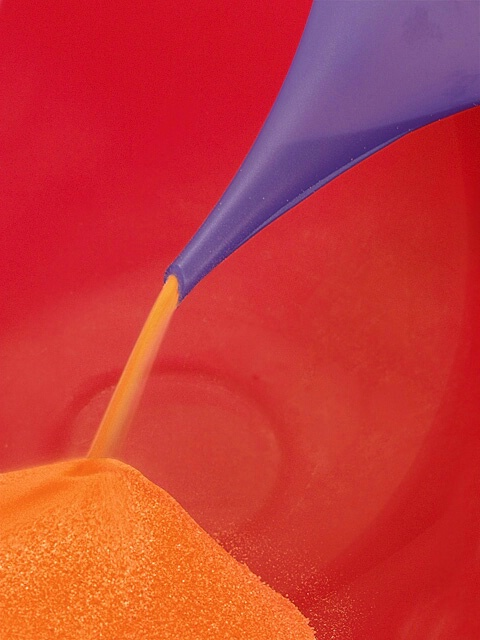 Orange Sand Through Purple Funnel Into Red Bowl