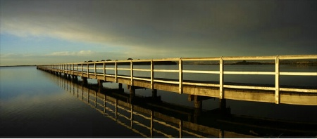 Coming of a Storm by the Lake Pier