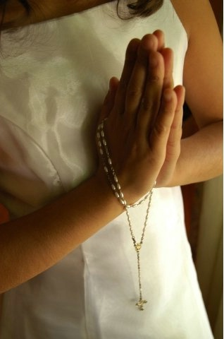 Hands in Prayer with a Rosary