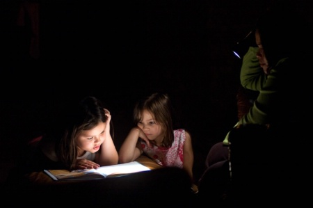Reading By Flashlight