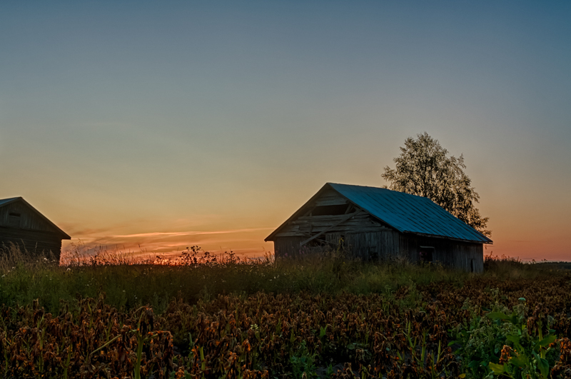 Barns And A Dramatic Sunset