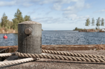 Old Bollard And Ropes