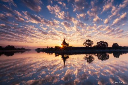 Sunrise over Mandalay Palace.