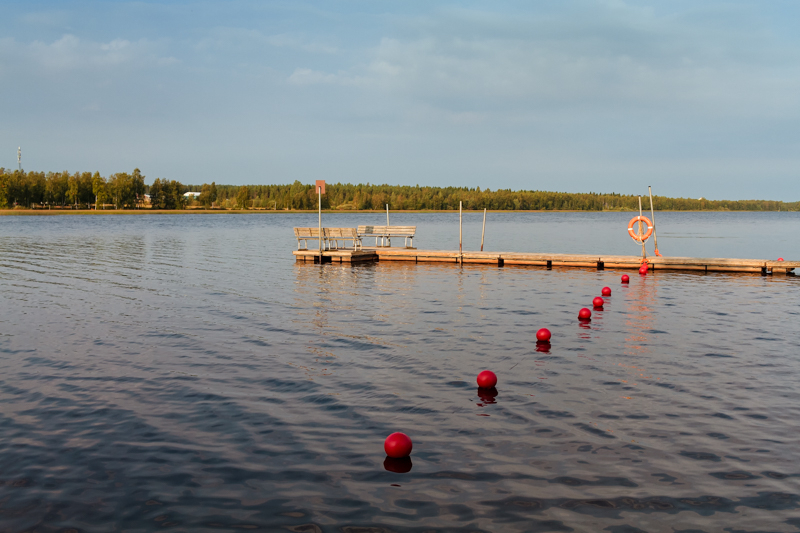 Pier And Buoys On The Lake