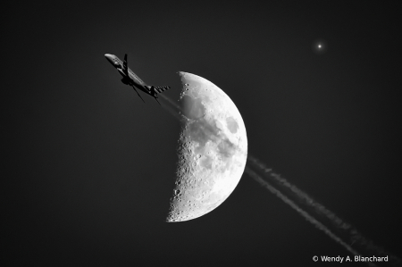Moon and Plane with smoke trails