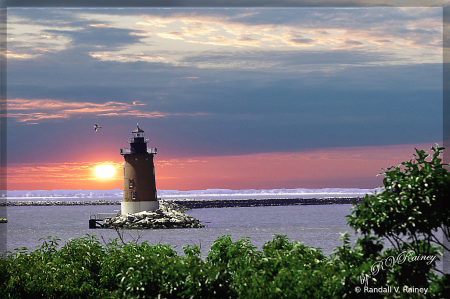 Sunset at the North Breakwater lighthouse . .