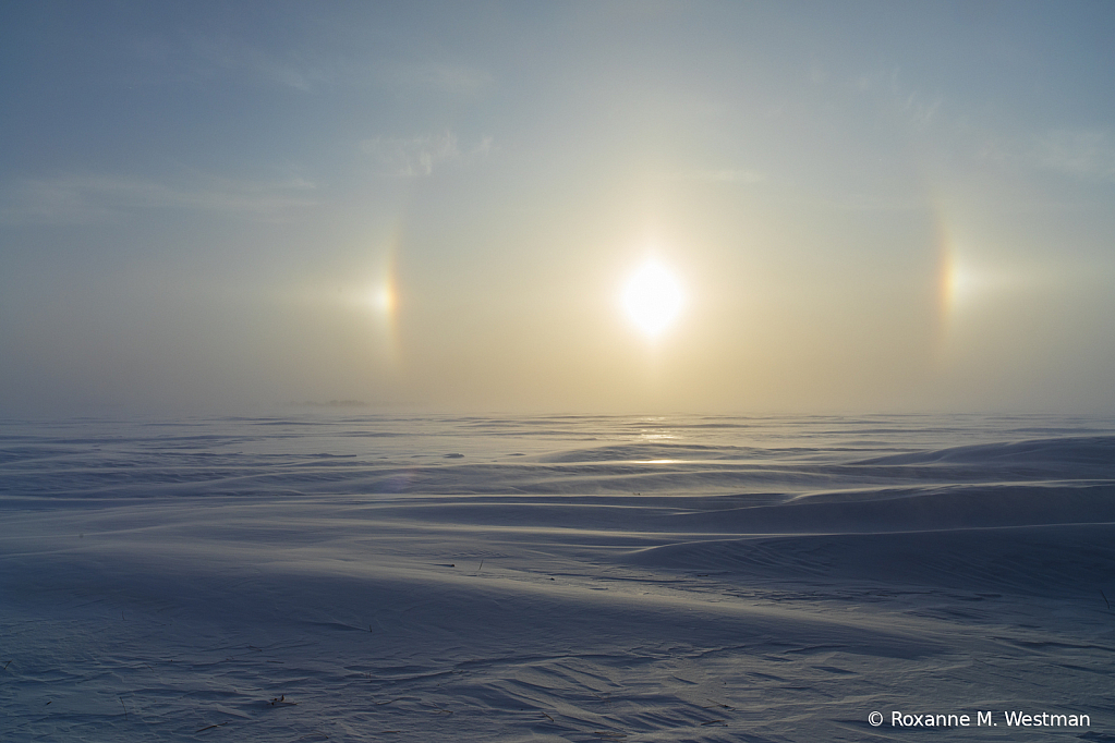 Beautiful sundogs on snowdrifts - ID: 15786354 © Roxanne M. Westman