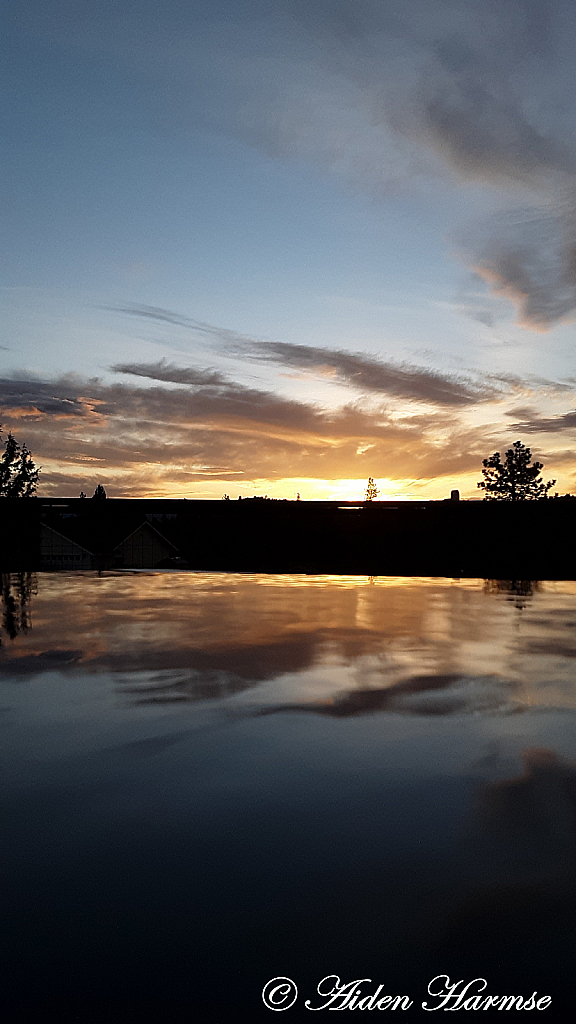 Sunset Over The Puddle
