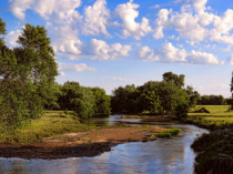 Puffy Clouds Over The Shell Rock River