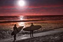 Surfers at St. Augustine Beach, FL