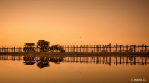 Reflection of wooden bridge.