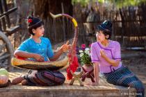 Playing Burmese Harp