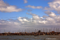 Clouds over masts