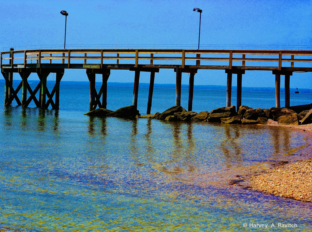 Long Pier On Colorful Beach ..