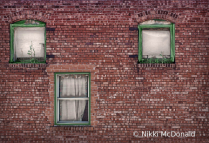 Three Windows in Brick Building