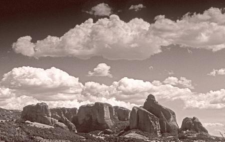 Cloud layers over Meteora rocks.