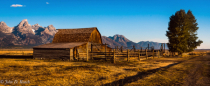 Fences, Barn, Tetons and Autumn Morning Light