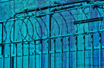 Blue Wall and Barbed Wire