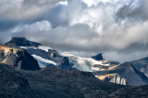 Snow and Glaciers Winding Between Mountains