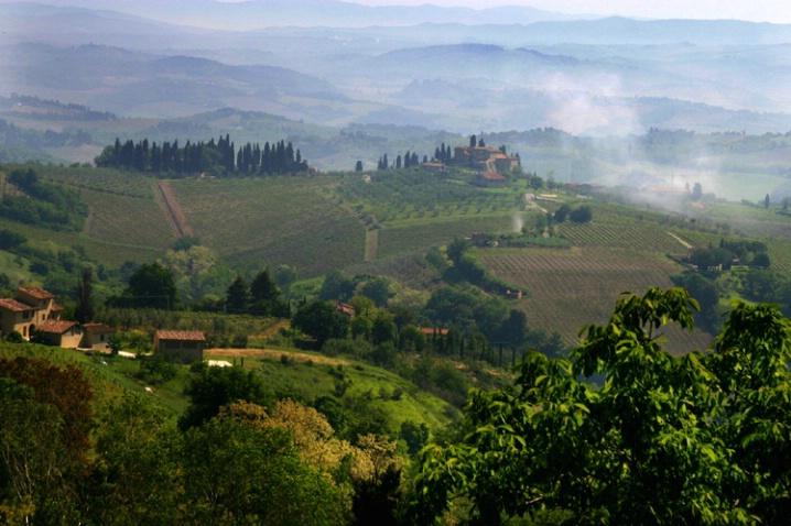fog lifting over Tuscany