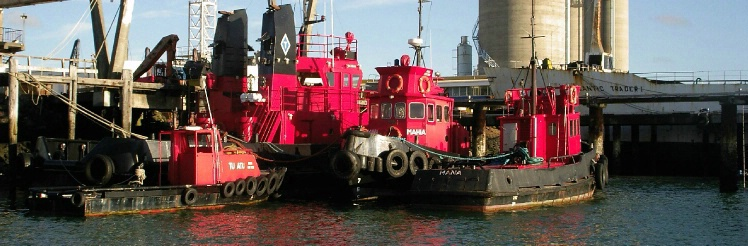 Red tugs Auckland NZ pano