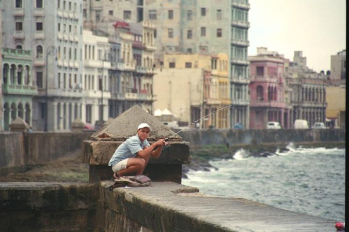Cuban Boy Fishing on Sea Wall