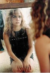 Girl in mirror.