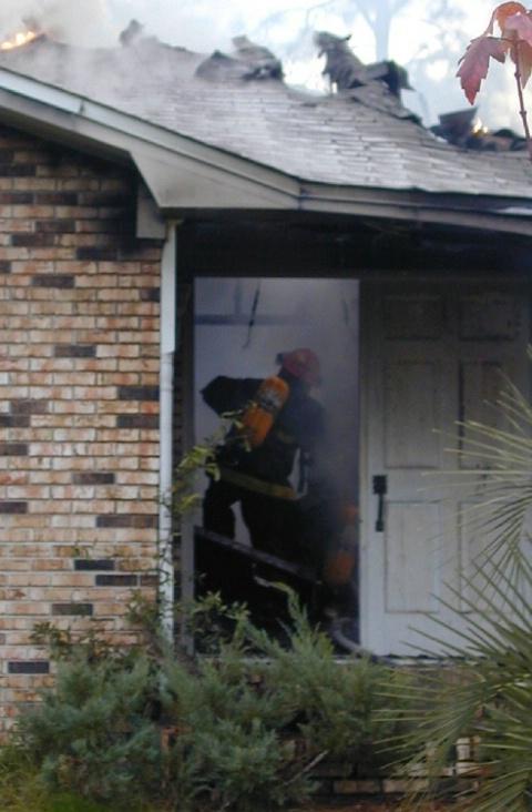 Firemen inside burning house