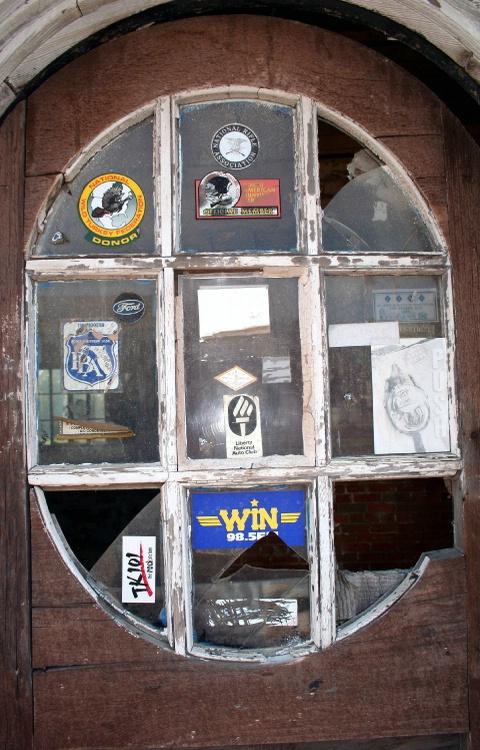 Window at Moo's Garage in Jay, Florida