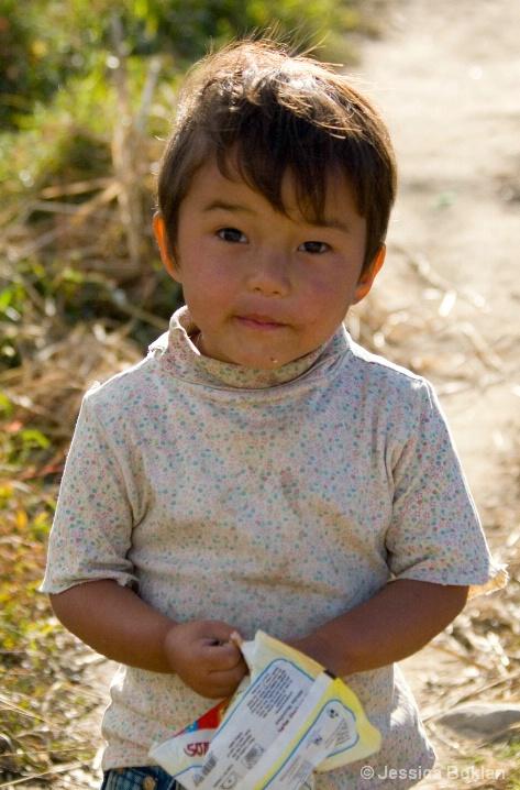 Bhutanese Boy with Potato Chips