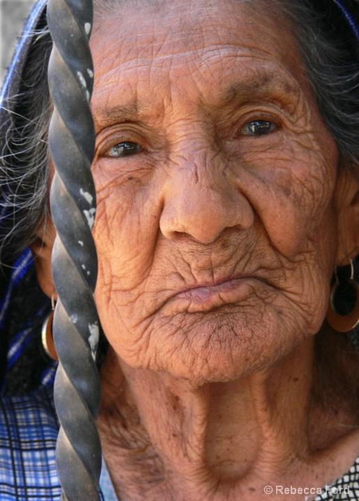 Old Woman Behind Bars
