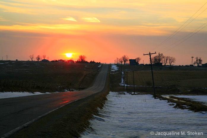 Winter sunset over the Iowa roadway