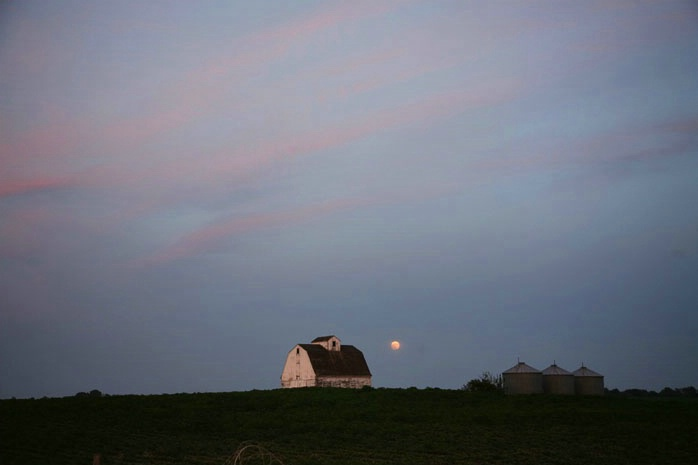 Full moon rising over farmland