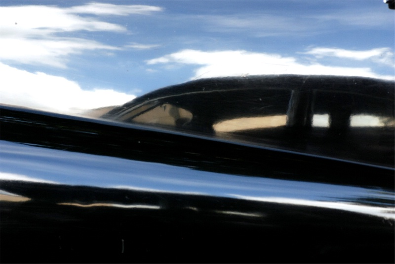 REFLECTIONS OF A CAR ON A POLISHED CAR