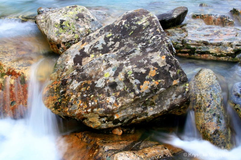 Mossy rocks in the river - rocks and water