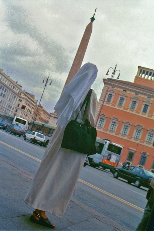 Egyptian obelisk & nun in Rome