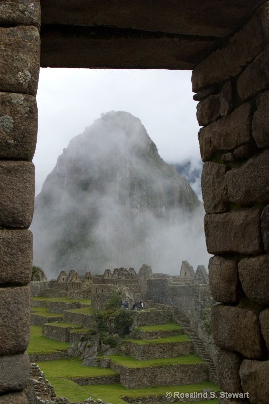 Wayanpicchu through doorway at Machu Picchu