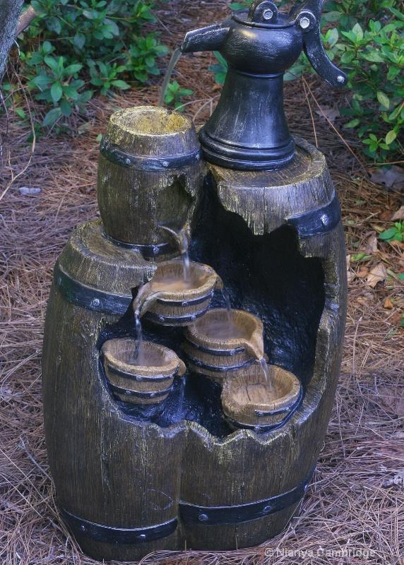 oak barrell fountain at twilig
