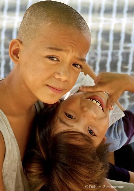 Two happy street boys near Rizal Park
