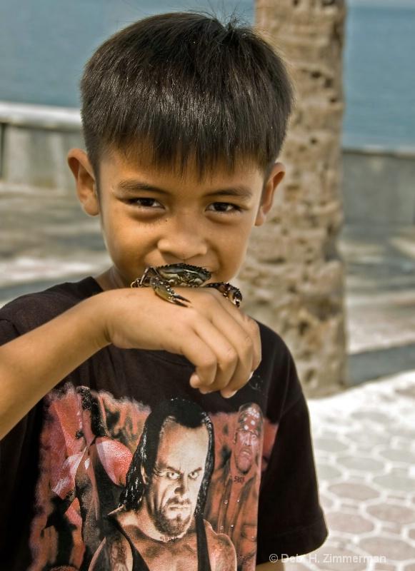 Boy with pet crab on Bay walk