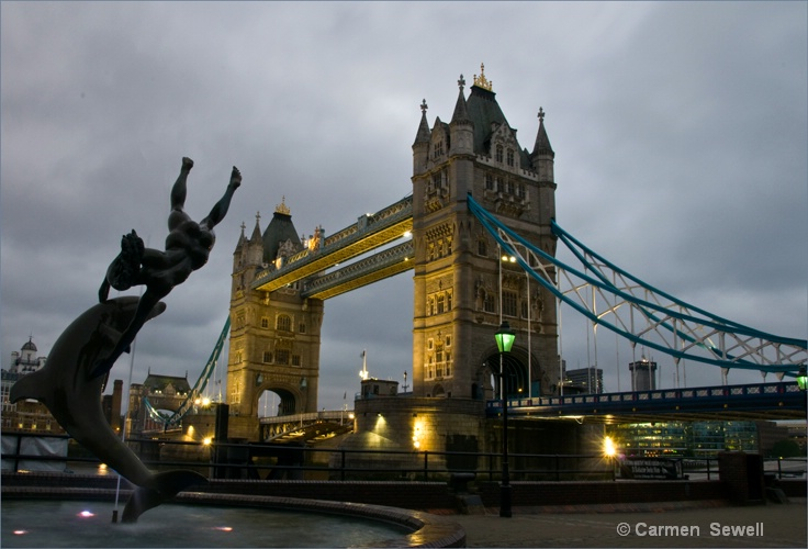 Tower Bridge and Girl with Dolphin Statue
