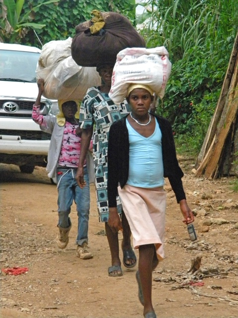 people walking home after market day